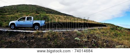Pickup Truck Traversing An Island