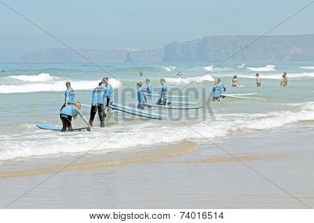 VALE FIGUEIRAS, PORTUGAL - August 20 2014:  Surfers getting surf classes on the famous surfers beach Vale Figueiras in Portugal