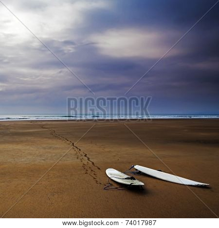 Surfboards On Beautiful Wild And Deserted Beach.