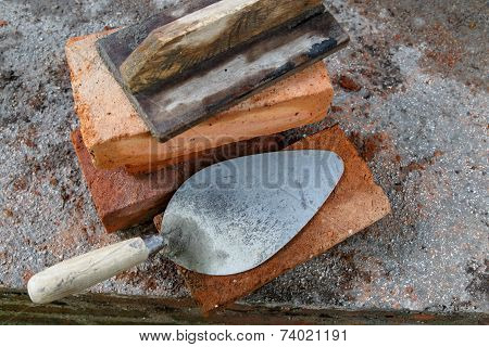 Construction Lute Trowels In A Brick Wall