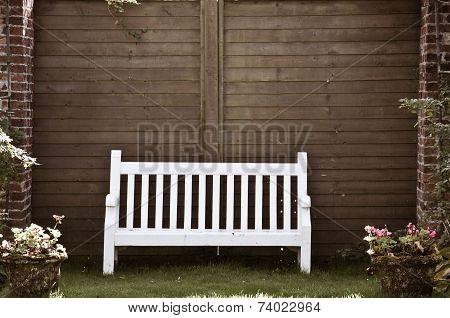 White Wooden Garden Bench In English Garden, Retro Color Filter Applied