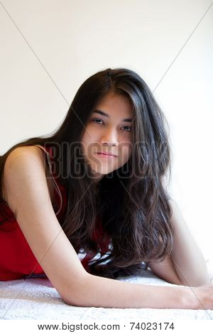 Beautiful Biracial Teen Girl Lying Down, Relaxing