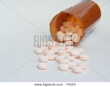 Pill Bottle Spilling