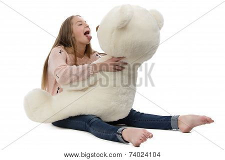 Photo of naughty teenage girl with teddy bear