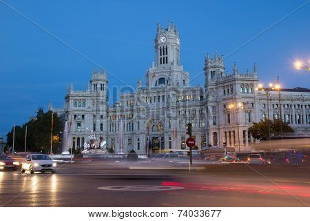MADRID, SPAIN - OCTOBER 10, 2014: The Madrid City Hall building at night.  Formally it was the Spanish Postal Service office until 2007 when it was converted into the City Hall offices.