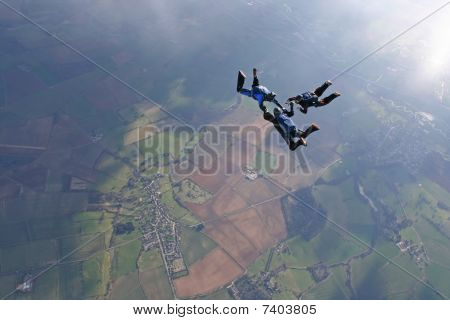 Three skydivers in freefall