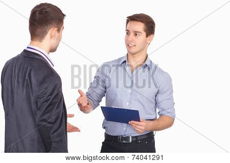 Two business men shaking hands and one of them holding a folder with contract