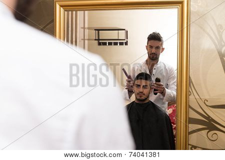 Reflection Of Hair Stylist Doing Hair Style