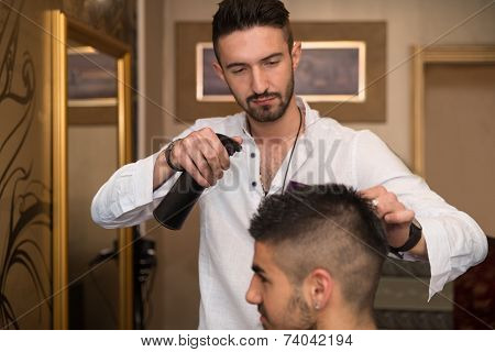 Male Hairstylist Water Sprayer On Hair On Hair