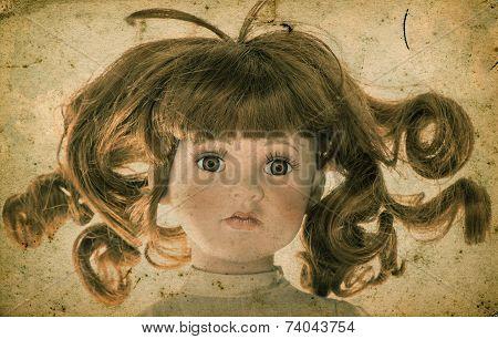 Antique Doll. Vintage Toy. Retro Toned Picture