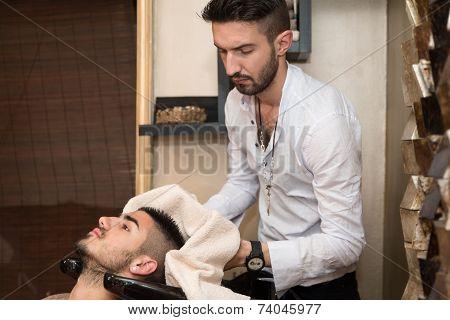 Washing Man Hair In Beauty Parlour Hairdressing Salon