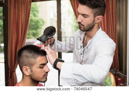Hairdresser Blow Dry Man's Hair In Shop