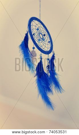 Blue dream catcher on a light background