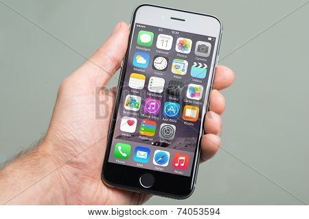 Hand Holding An Apple Iphone6 With Various Apps On Screen