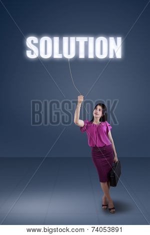 Businesswoman And A Solution Text