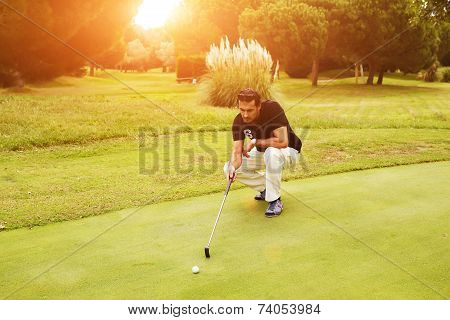Professional golf player looking trajectory of the ball