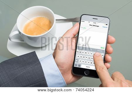 Businessman Text Messaging On Apple Iphone 6