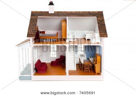 Child's Doll House With Furniture On White