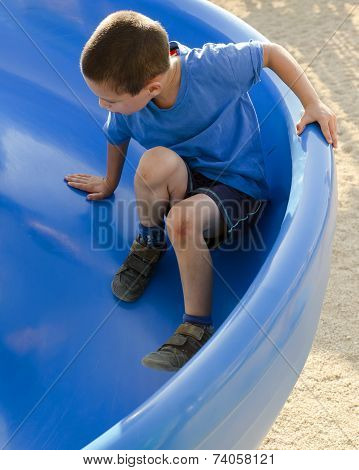 Child On Slide At Playground