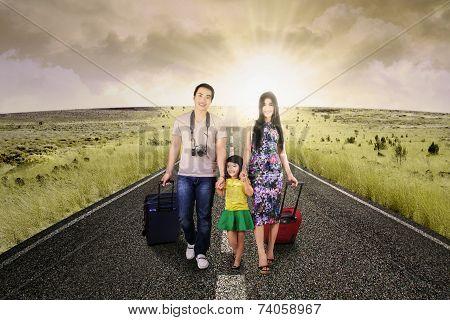Hispanic Tourist Walking On The Road