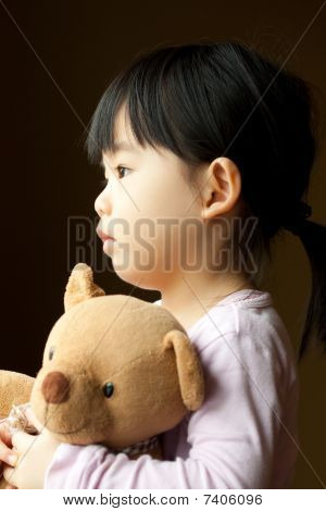 Sad Little Girl With Teddy Bear