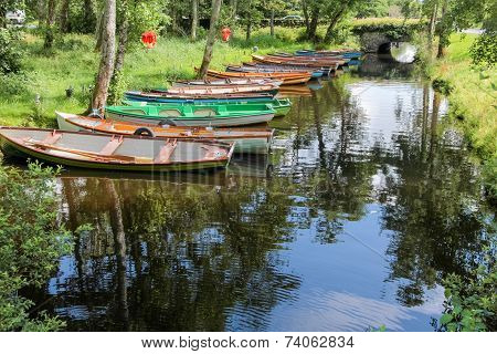 Rowing Boats On A Peaceful River