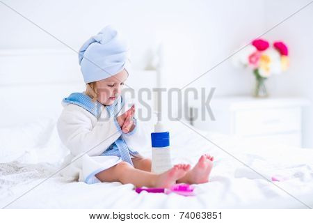 Litlte Girl In A Bathrobe And Towel