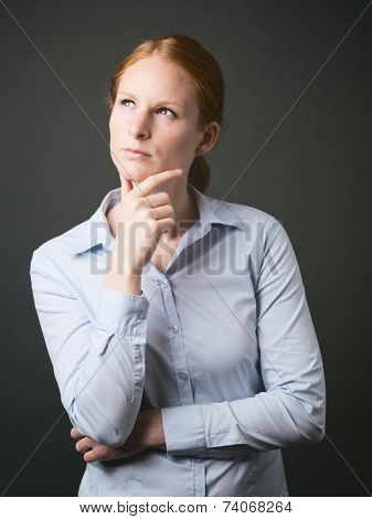 Woman Thinking Of Business Solutions
