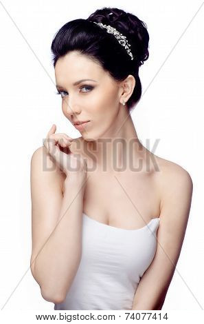 Young woman with beautiful hairstyle isolated on white studio background