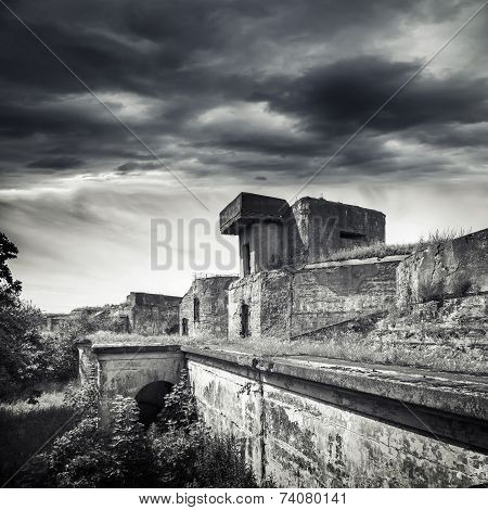 Old Bunker From Wwii Period. Monochrome Photo