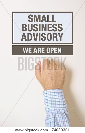 Businessman Knocking On Small Business Advisory Door