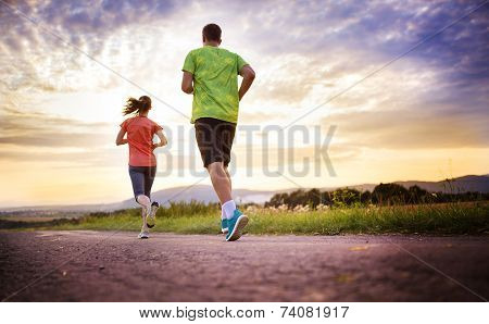 Couple running at sunset