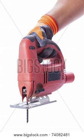 Hand In A Glove Holds A Working Electric Jig Saw