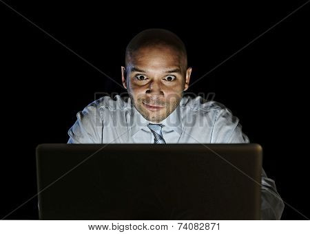 Businessman Alone At Night Sitting At Computer Laptop Watching Porn Or Online Gambling