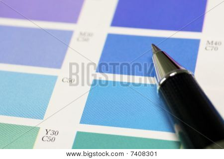A Pen And Blue Process Color Chart