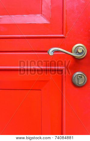 Classic Door Handle On Red Door