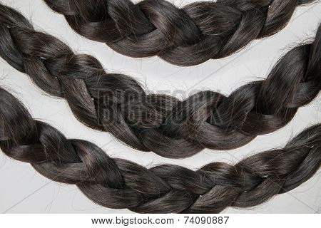 Hair Braided In A Braid On A Gray Background
