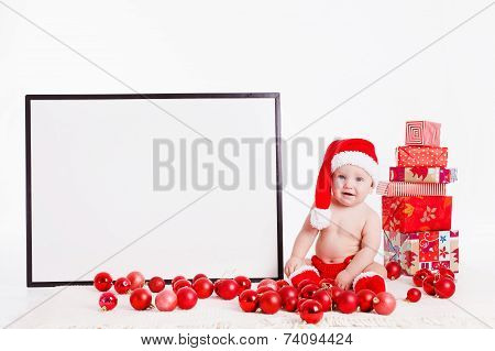 Cheerful boy in Santa Claus hat. Isolated on white background