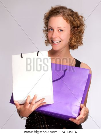 Girl Showing Her Shopping