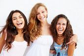 picture of 15 year old  - Portrait Of Three Teenage Girls Leaning Against Wall - JPG