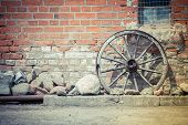 picture of ox wagon  - Old carriage wheel built into the wall - JPG
