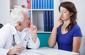 stock photo of neurology  - Male physician diagnosing patient with neurological problems - JPG