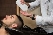 foto of beauty parlour  - Hairstylist Hairdresser Washing Customer Hair - Young Man Relaxing In Hairdressing Beauty Salon ** Note: Soft Focus at 100%, best at smaller sizes - JPG