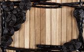 foto of licorice  - a wooden background with wheels and sticks of licorice - JPG