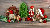 stock photo of nutcrackers  - christmas decoration with antique toys teddy bear and nutcracker - JPG