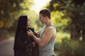 stock photo of say goodbye  - Woman and soldier in a military uniform say goodbye before a separation - JPG