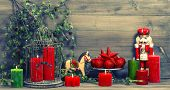 picture of nutcracker  - christmas decorations with red candles antique toys nutcracker and rocking horse - JPG