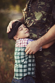 picture of say goodbye  - Boy and soldier in a military uniform say goodbye before a separation