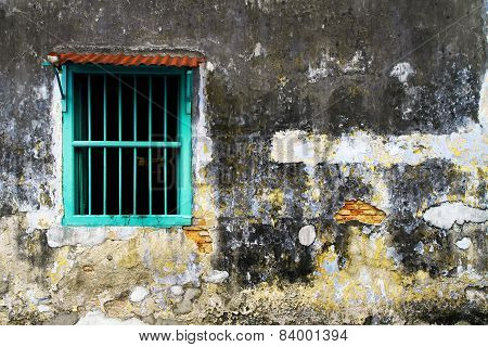 Faded old wall and window
