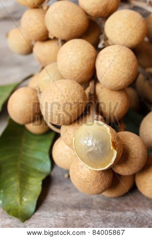 Longan On Old Wooden Table.